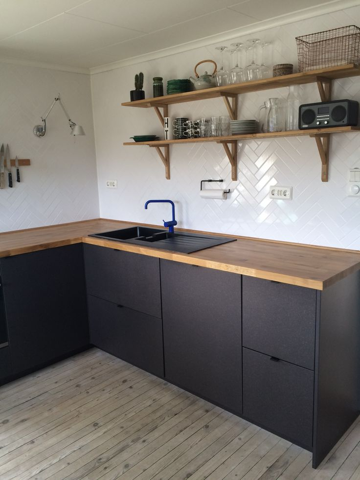 I like the wood counter and black cabinet... but Id put a white sink. I like the foating shelves, but not the corbles. Valchromat IKEA kitchen studio10