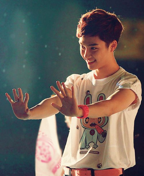 D.O. he's cute in this photo what he's doing here Idk & Idc he's cute:)