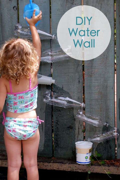 X-DIY Water Wall, boys enjoyed...however, Luke is still young enough to want (and succeed at) pulling the bottles off. We built our around a wooden pole in the backyard : ) Neat!