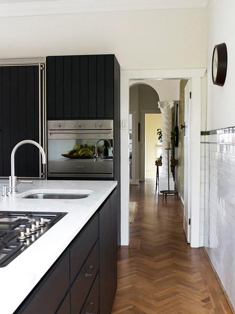 black cabinets white counters herringbone floors