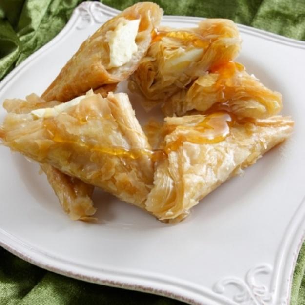 Recipe for Trigona Panoramatos (Triangle shaped phyllo pastries stuffed with custard cream)