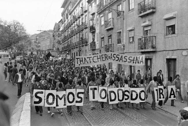 """Demonstrators spelling out """"We are all IRA"""" protest the death of Bobby Sands at a Lisbon, Portugal on May 6, 1981 march on the British Embassy."""