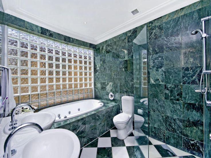 Modern bathroom design with recessed bath using tiles - Bathroom Photo 498839