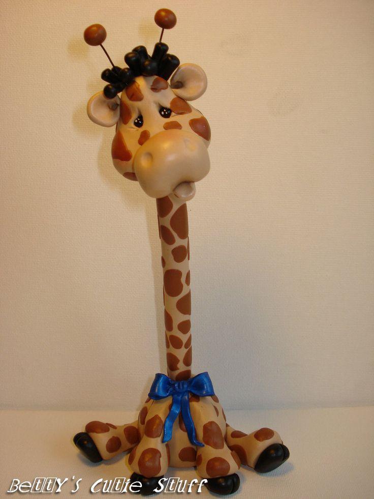 Giraffe Pen Polymer Clay Figurine Collectible by bettyscutiestuff. $25.00, via Etsy.