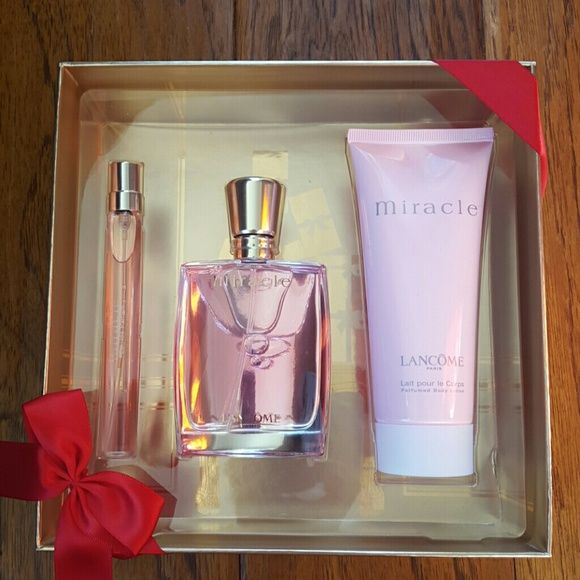 Lancome Miracle perfume and lotion set New Miracle perfume and lotion set. Comes with .0.34oz purse spray, 1.7oz Eau de Parfum spray, 3.4oz perfume body lotion. Bought for a friend but ended up giving her something else! Value is $106 but I bought it for $71. Comes in a beautiful red and gold gift box. Lancome Other