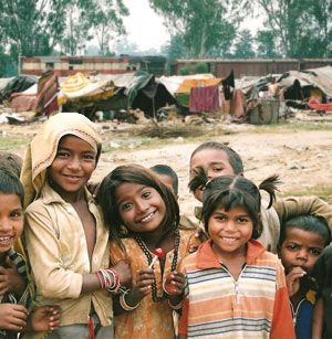 """Mumbai, India. Of course I want to see the Taj Mahal, The Lotus Temple and all the other cool attractions... but first I'd like to see the beautiful faces of the children of the """"slums"""". My trip to India will be a meaningful experience of service. :)"""
