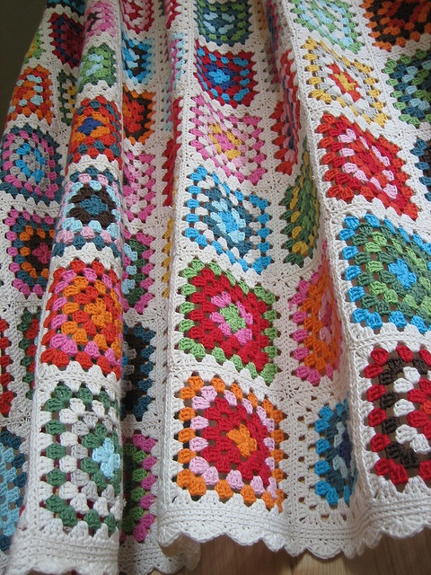 I think my next crochet project should be this.  I love the colorful squares with the white.