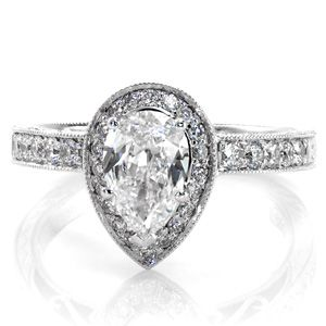 Beautiful diamond engagement ring is a mix of the new halo style and a more vintage Pear cut center stone. The halo and band are both done in micro pave. Pear Valencia from Knox Jewelers #halo #micropave