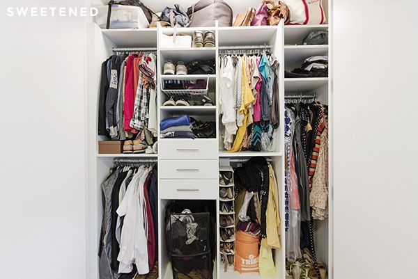 Brooklyn bedroom closet features bright all-white materials and interior lighting now house a wide range of wardrobe necessities with dedicated spaces for bags, shoes, a hamper, and folded clothes.