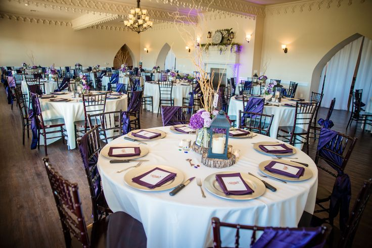 Our reception area had lavender sashes tied to every other chair, purple cloth napkins, and individual centerpieces for each table. We also rented purple up-lighting from our DJ to highlight the bride and groom's sweetheart table.