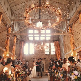Twinkle light and burlap ceremony decorations at a rustic barn wedding