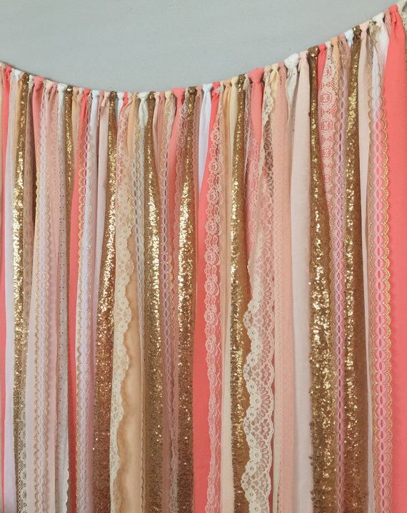 Coral, peach and gold garland curtain is made with a blends of ivory, white, coral, peach and sparkley gold sequin and lace. Torn and rag tied -