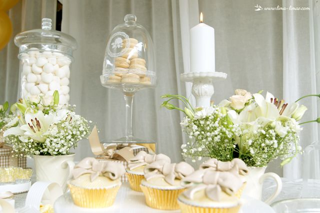 The candles give a nice touch  for this white and gold glamour baptism party