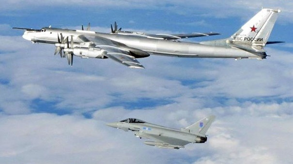 "RAF Typhoon with one of the russian Tu-95s ""Bear"""