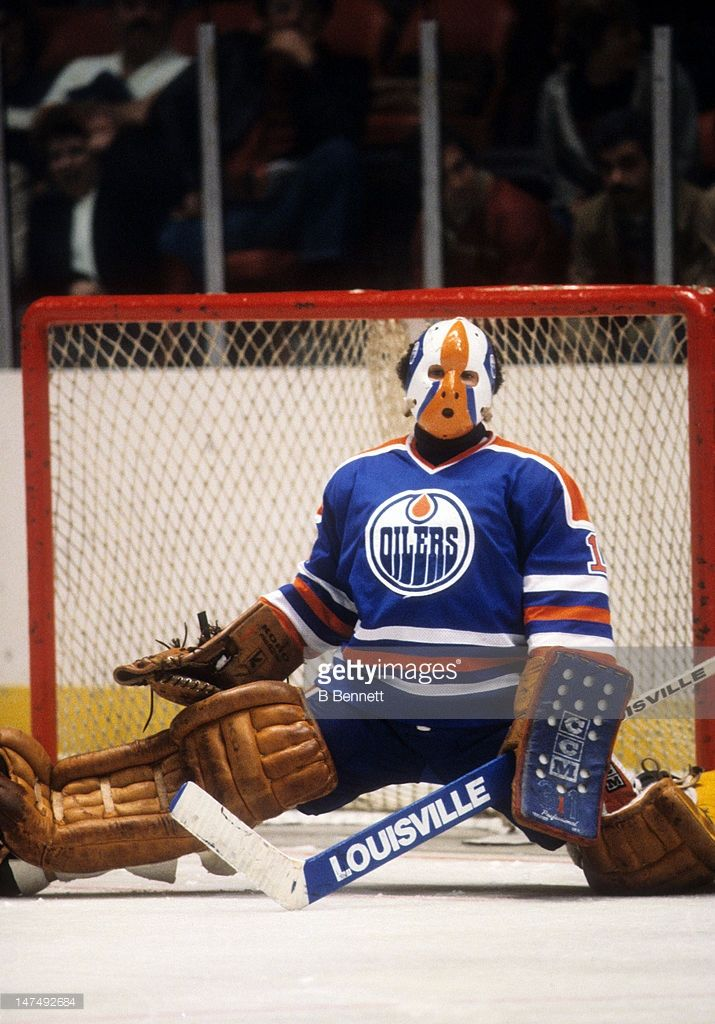 goalie-grant-fuhr-of-the-edmonton-oilers-defends-the-net-during-an-picture-id147492684 (715×1024)