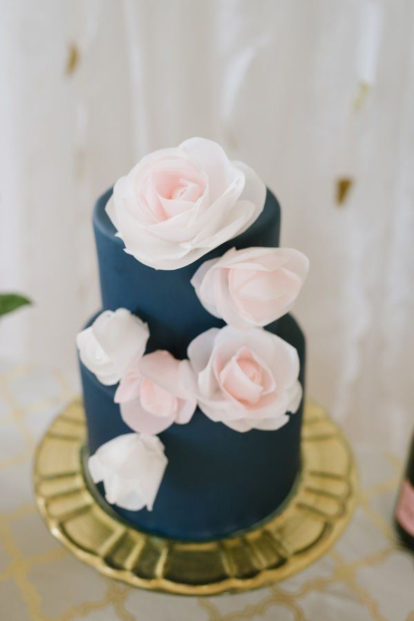 navy blue wedding cake with blush flowers