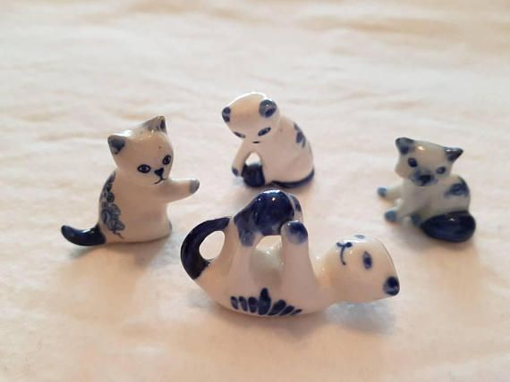 Check out this item in my Etsy shop https://www.etsy.com/ca/listing/582818724/set-of-4-miniature-porcelain-cats-white