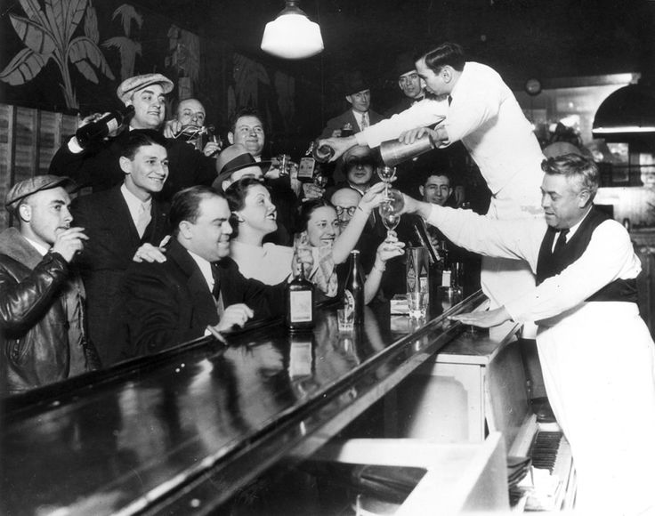 Bartenders at Sloppy Joe's bar in Chicago pour a round of drinks on the house for a large group of smiling customers as it was announced that the 18th Amendment had been repealed and Prohibition had been removed from the US Constitution after 13 years.This Is What America Looked Like When Alcohol Was Illegal