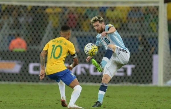 November 11 2016 - Neymar gets the better of Barcelona team-mate Lionel Messi as Brazil beat Argentina 3-0 in World Cup qualifier