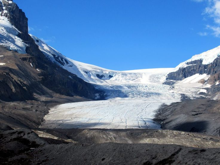 The Athabasca Glacier at the south end of Jasper National Park in Alberta, Canada, is easily accessible off the Icefields Parkway. Tourists can hike or ride a bus right up onto the glacier's surface.