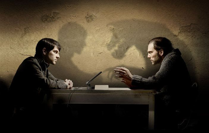 Nick (The Grimm) and Monroe (A Blutbad) at a interrogation.  The shadow cast of Monroe is shows his wolf self.  #Grimm #TV