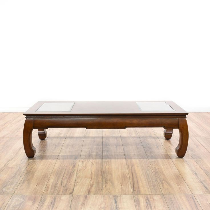 This coffee table is featured in a solid wood with a glossy mahogany finish. This Asian style cocktail table has chow legs, glass panel accents, and carved trim. Perfect for holding drinks! #asian #tables #coffeetable #sandiegovintage #vintagefurniture