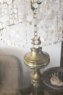 this button lamp shade is the cutest. Love this idea! But what color buttons with old white porcelain lamp bases? Hmm