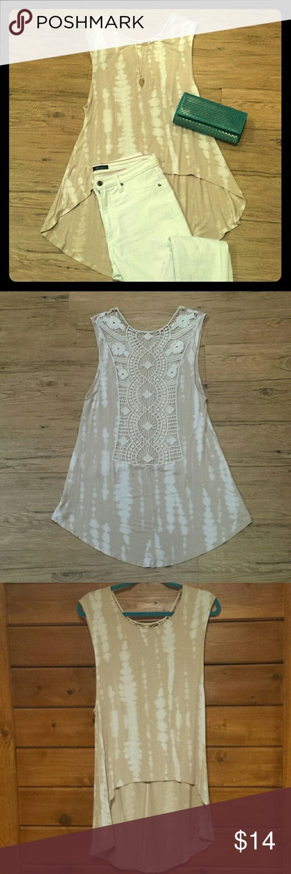 Tie dye hi/lo tunic Beige hi/lo tunic with lace detail on the back. The lace is cut out and this top requires a cami or bralette. Great paired with white skinnies! Tops Tunics