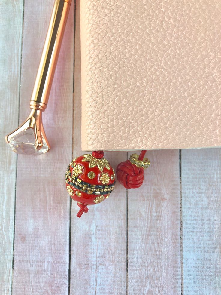 etsy shop: Travelers Notebook Bookmark, Page Marker, Beaded charm, bookmark thong, TN Charm, Book Thong, TN page marker,   monkey fist bookmark for tn
