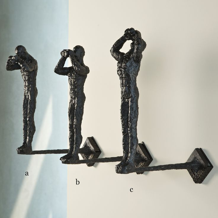Looking wall art. Three unique wall hanging sculptures.