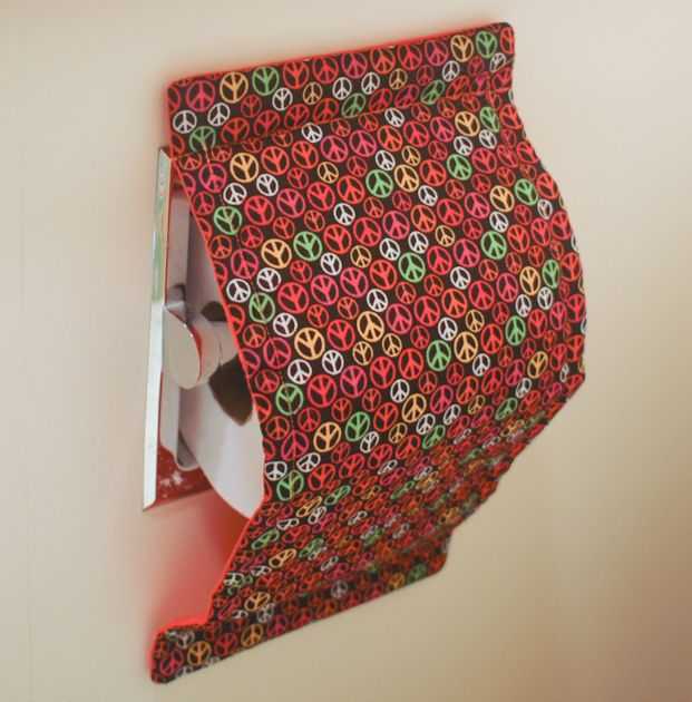 Paws free toilet paper cover...I'm going to try this to see if it stops the cats from savaging the toilet paper!  Comes in a ton of patterns.