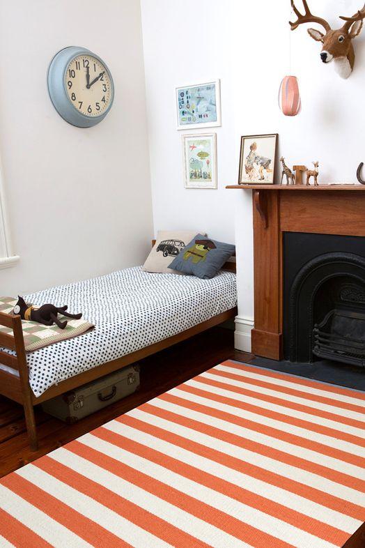 Armadillo Carnival Stripe rug and spotty duvet