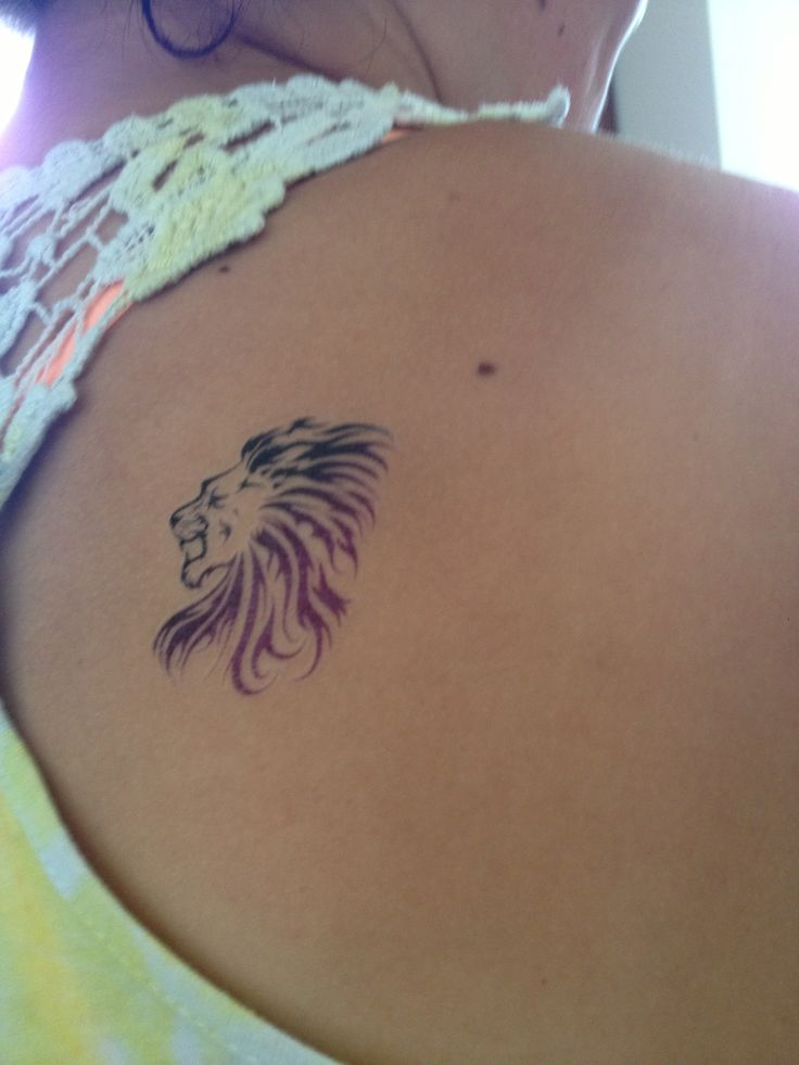 Small lion tattoo on shoulder