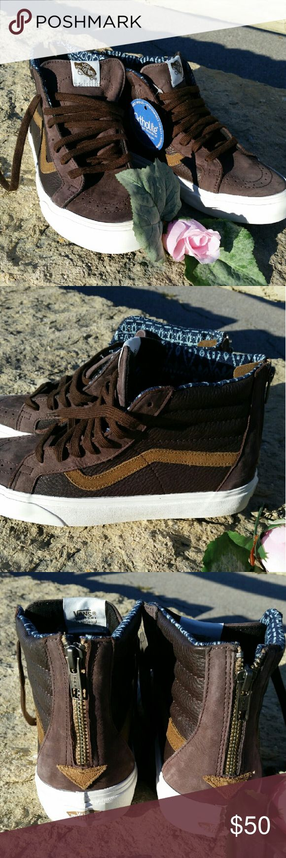 """Unisex Vans """"Off The Wall"""" NWT high top tennis shoes.  """"World's number one Skateboard Shoe"""" Sizes Women 10.0 -Men 8.5 Leather top, inside in a navy blue and light blue aztec print. Smoke and pet free home. Vans Shoes Athletic Shoes"""