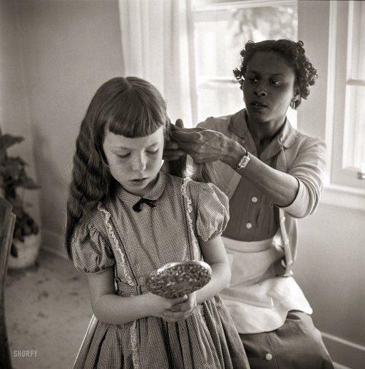 """February 1956. """"Domestic worker fixing girl's hair."""" From photos by Bern Keating for the Look magazine article """"The South vs. the Supreme Court: What Is a Southerner?"""" Library of Congress Prints and Photographs Collection."""