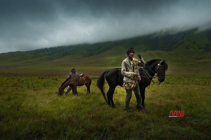 Tengger horsemen at Mount Bromo savanah, Indonesia.