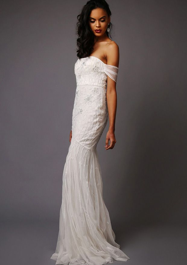 The Dominique wedding dress from Virgos Lounge made from a lightweight poly fabric- netting, bandeau neckline and trumpet style skirt - See more at: www.onefabday.com