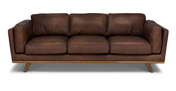 An oak wooden trim and voluptuous leather cushions define this sofa with an updated mid-century modern. Sink into the down filled cushions and relax — you've come home to your new favorite place. Each hide used for upholstery is as unique as a fingerprint. Natural color variations, wrinkles and creases are part of the unique characteristics of genuine leather.
