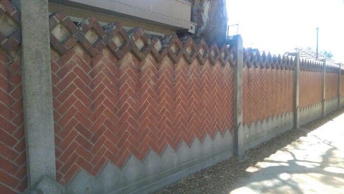 Herringbone red brick boundary wall