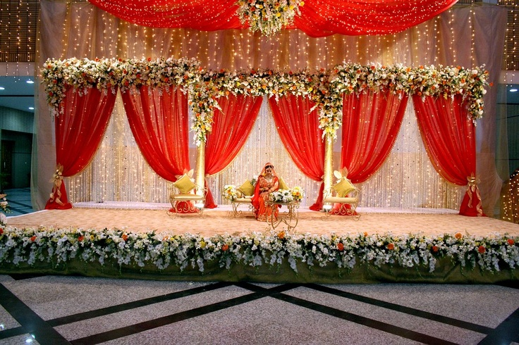 stage for an Indian wedding - I love the flowers and draping!
