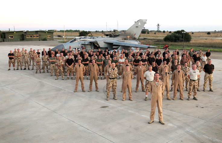 Personnel from 2 Squadron, RAF, pose in front of Tornado GR4 ZD746 '094' at Gioia del Colle, Italy, on August 19, the day on which the unit handed-over control of the aircraft deployed for Operation Ellamy to 9 Squadron. UK MOD Crown Copyright/SAC Sally Raimondo