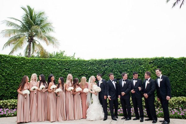 champagne bridesmaid dresses and black tuxes on groomsmen