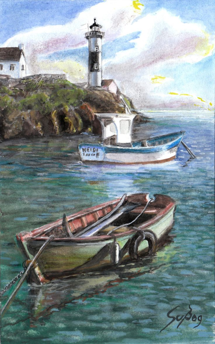 Lighthouse and boats at the coast of Brittany