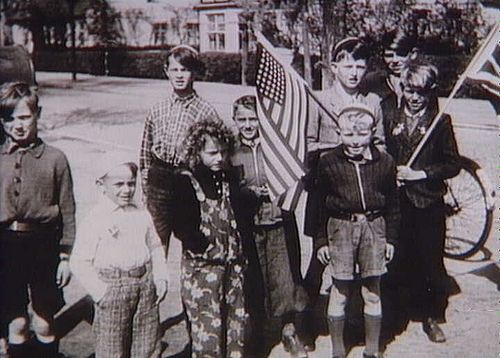 Danish children with british and american flags, May 1945