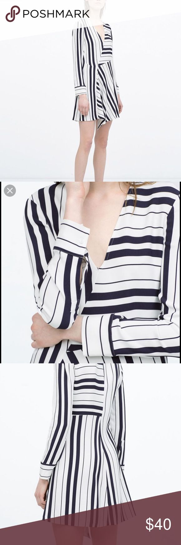 ZARA Dress Navy White Longsleeve Dress size Small ZARA Navy White Longsleeve dress. Asymmetrical hem. Abstract all over nautical stripe. Cuffs at sleeve. Fits true to size. Will accept reasonable offers but no trades. Zara Dresses Long Sleeve
