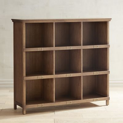 """Unique"" and ""modern"" hardly do justice to the design and construction of this bookcase—so we're going with ""Graham-tastic."" By all means, run your hand over it and savor the smooth surface. But don't let it distract you from the nine cubbies (each 13.50W x 12""D x 11.50""H) that can hold books or display trophies and other ""pretties."" It can also accommodate baskets to store supplies or craft projects."