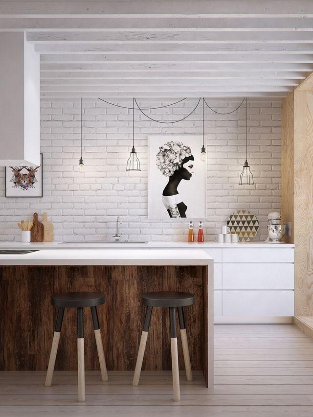 A mistura do branco com a madeira deixa o ambiente com cara de moderno, mas sem perder o conforto. Quem disse que cozinha não pode ter quadros? Pode sim. Basta que ele seja feito com um material que seja fácil de limpar.