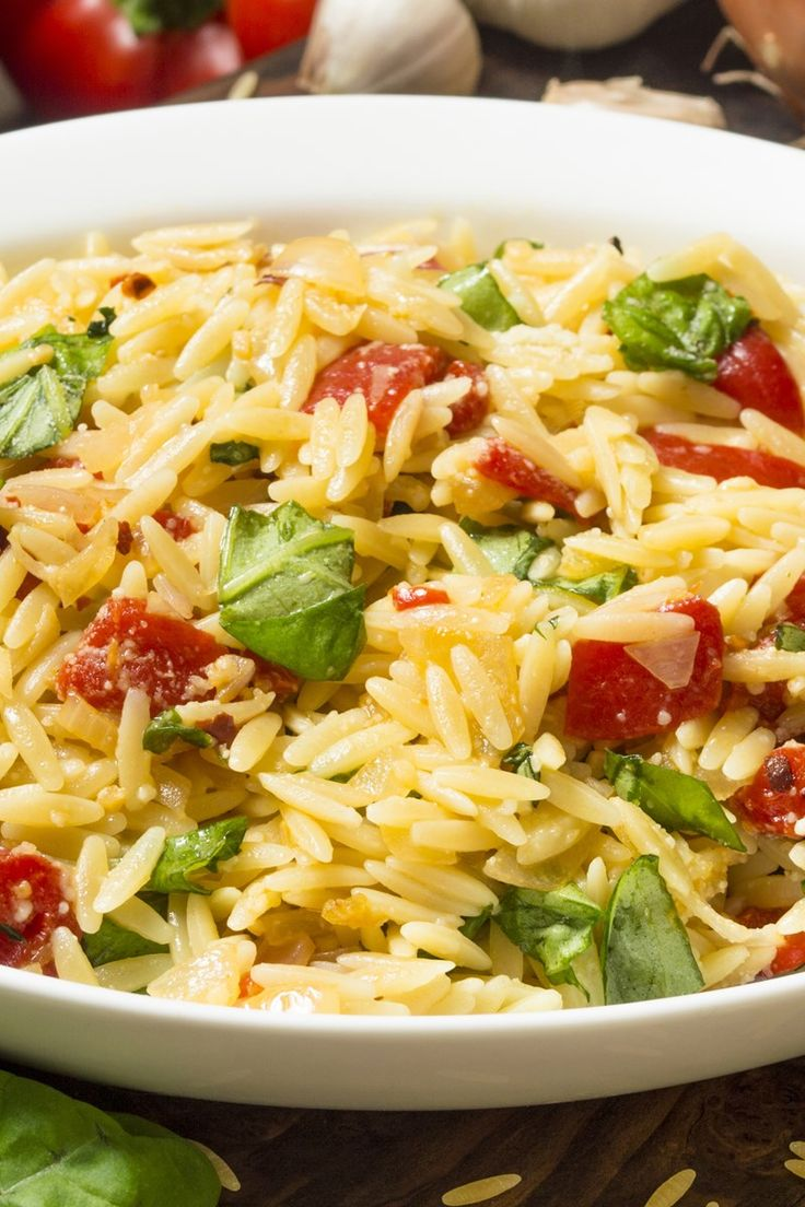 Tomato and Basil Orzo Pasta Salad Recipe - orzo, Roma tomato, fresh basil, and parmesan cheese in a white balsamic vinaigrette.