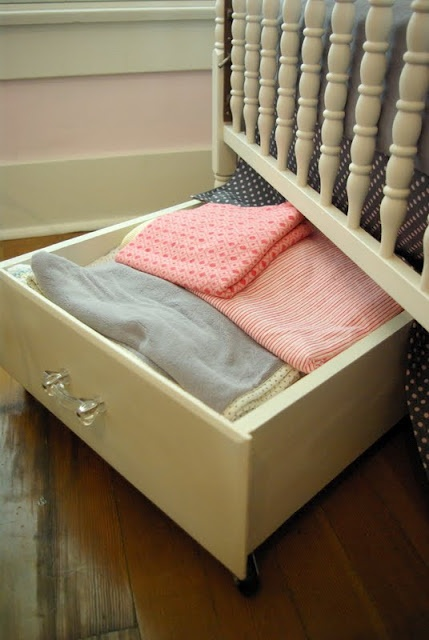 Use old drawers with wheels on the bottom to create under the crib (or bed) storage