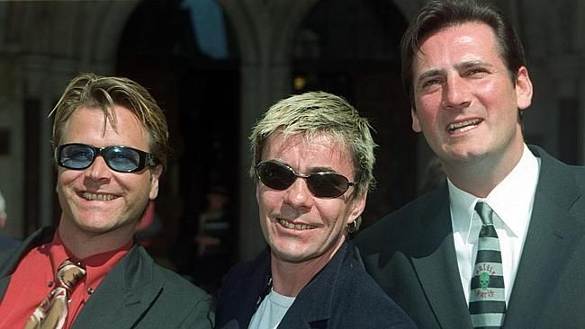Steve Norman, John Keeble and Tony Hadley outside the High Court in London in 1999 where